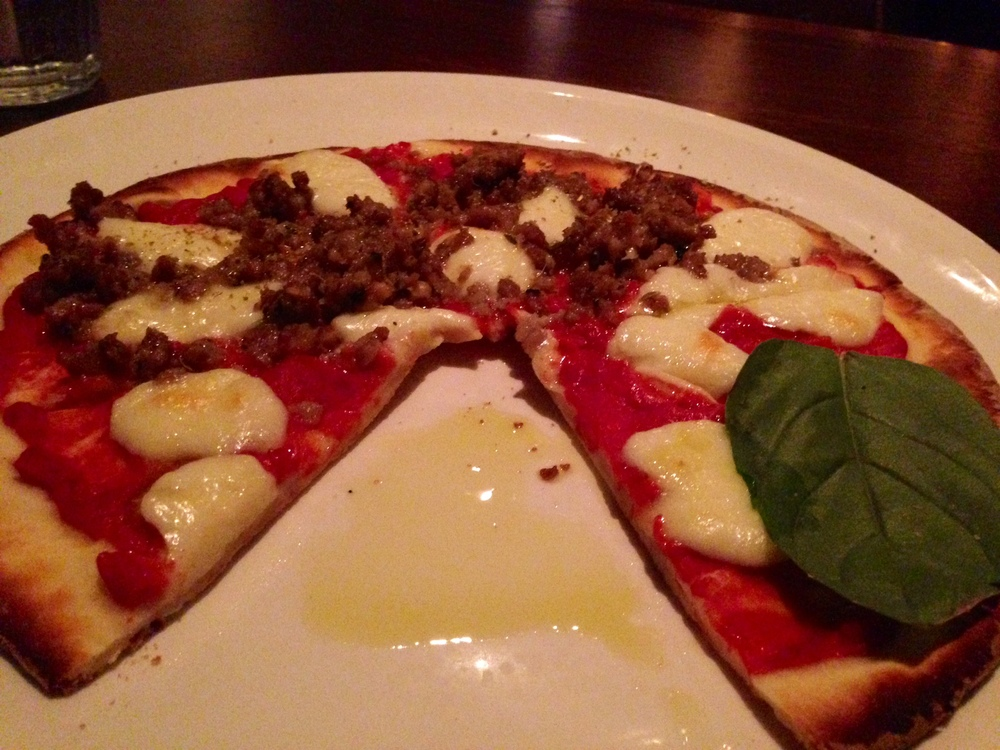 Red-  Half  House-Made Pork Sausage:  fresh mozzarella, fennel sausage    Half  Margherita : fresh mozzarella, basil, extra virgin olive oil YUM!!!! I Loved this pizza too! I think truffles will alway take the cake for me, but their red sauce is phenomenal: incredibly fresh and delicious. And who doesn't love fresh basil on a pizza? Also, their homemade sausage is really flavorful and delicious. I would absolutely order this again too.