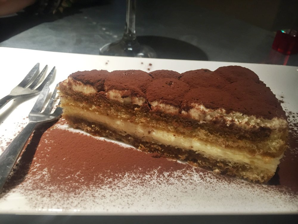 "This was their ""famous"" tiramisu. We were so full, but they told us it was worth it. I don't eve like tiramisu, and I loved this! Don't miss out!"