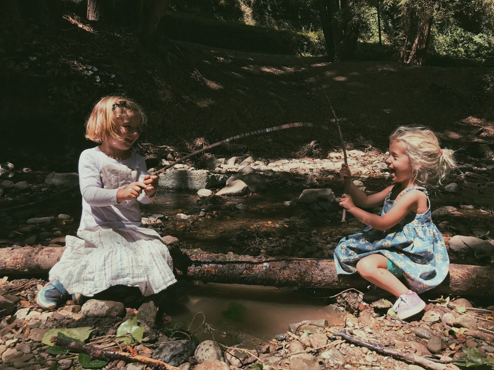 "After lunch, kindergarten-aged students spend every afternoon in the local woods getting dirty—playing in the creek, exploring fairy rings, ""painting"" faces, and much more."
