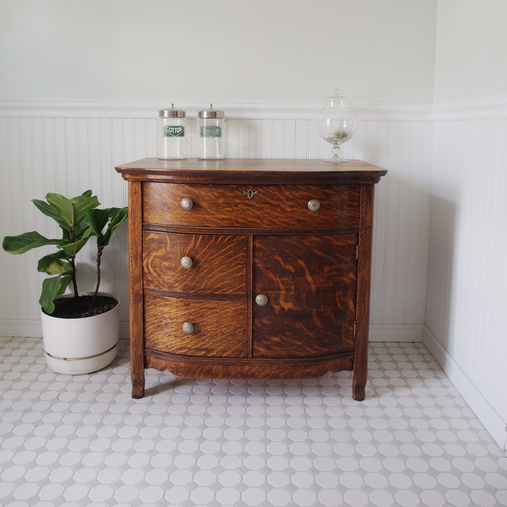 All of the furniture upstairs is re-purposed or vintage. The little antique bathroom dresser was restored to it's original beauty by Greg's parents.
