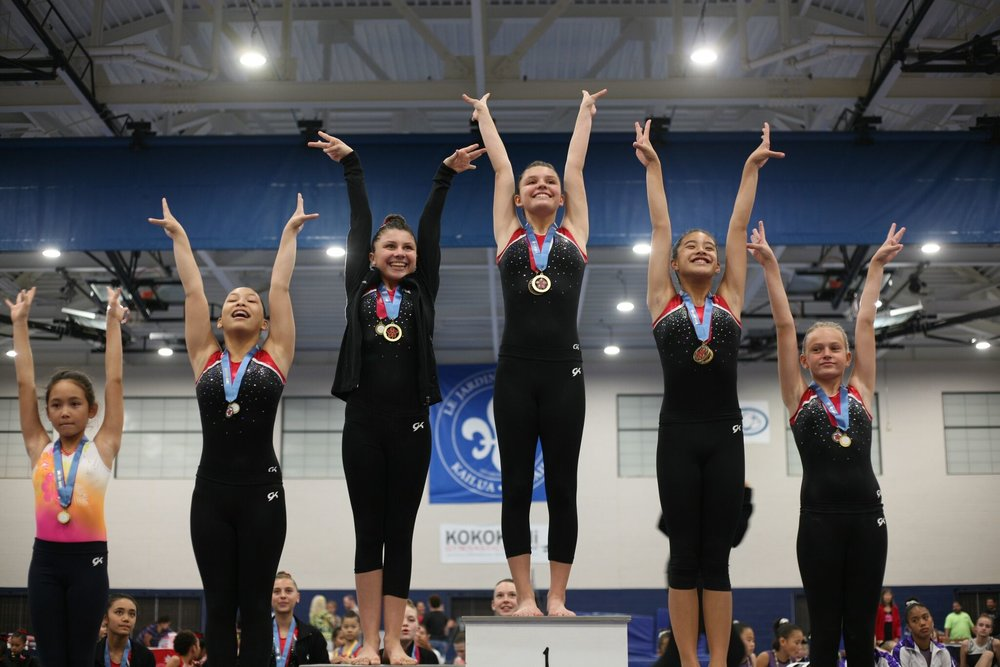 Lorianna Herrmann, from our homeschool program, stands on the 1st place podium for uneven bars with a score of 9.700 (the highest score of the competition). In 2nd place, also from our homeschool program, Micayla Herrmann with a score of 9.625.