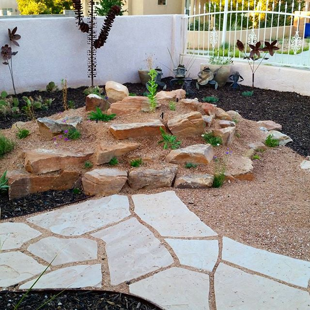 A shot of the completed #rockgarden at one of our installs this #summer. Though the #plants are small now, they'll soon fill most every crevice around these #stones #southwesthorticulture #botany #rock #garden #natural #gardening #flagstone #flora #botany #nature #southwest #horticulture #Albuquerque #newmexico #landscapedesign #landscape #landscapes #landscaping