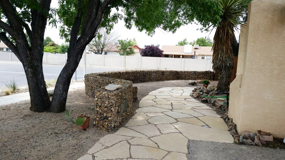 "One of our latest   #hardscape   designs. This   #gabion   wall is 3 feet by 70 feet long and 18"" deep. They can be used as retaining walls or, like in this case, a decorative, free-standing privacy screen. Of course we created the   #flagstone   patio as well.   #Native   plantings will be coming soon to compliment and complete this project."