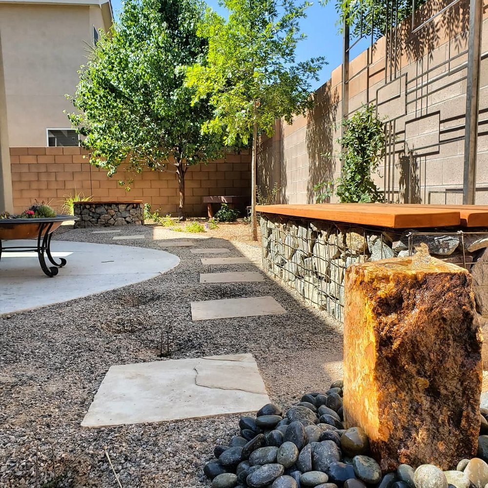 The finished product on the more formal xeriscape design I posted a while back. The #gabion seat walls and #flagstone path were just what this space needed to become a garden that people will want to spend time in rather than just observe. The path will soon be carpeted with Creeping Thyme and Turkish Veronica, and the honeysuckle will quickly climb the welded steel trellis.  #southwesthorticulture #horticulture #landscapes #landscaping #landscapedesign #nativeplants #xeriscaping #xeriscape #waterconservation #gardening #albuquerque #newmexico