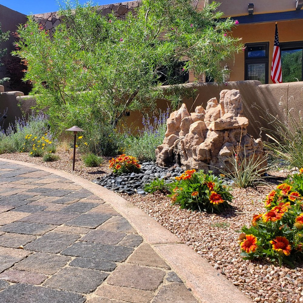 A look at one of our installs from this spring. This boulder had a lot of character and made a perfect fountain stone once we drilled a hole in the middle. The blanket flowers in front of the fountain are actually a native wildflower that blooms throughout the summer and tolerates hot, sunny locations.  #southwesthorticulture #horticulture #landscapes #landscaping #landscapedesign #nativeplants #xeriscaping #xeriscape #waterconservation #gardening #albuquerque #newmexico
