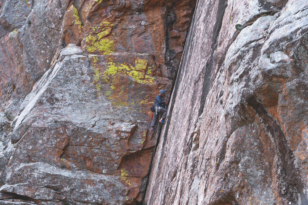 Zach placing some gear in the crack.
