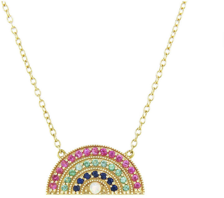 "This dainty 18 karat yellow gold necklace from Andrea Fohrman is the sweetest addition to your everyday layering wardrobe, a lucky rainbow detailed with pink and blue sapphires, emeralds, and an opal center. It measures 1/4"" long and is on a fine 16"" chain with a lobster clasp."