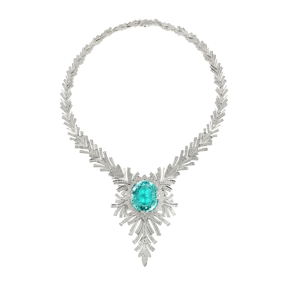 An impressive 91-carat Paraiba Tourmaline (the largest ever to appear at auction) set among more than 23 carat diamonds.