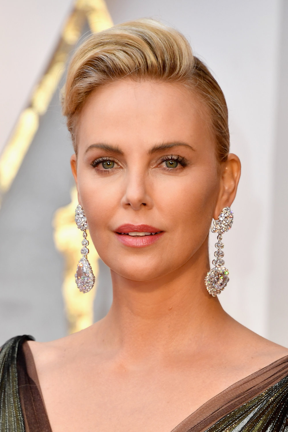 Actress Charlize Theron wearing Chopard