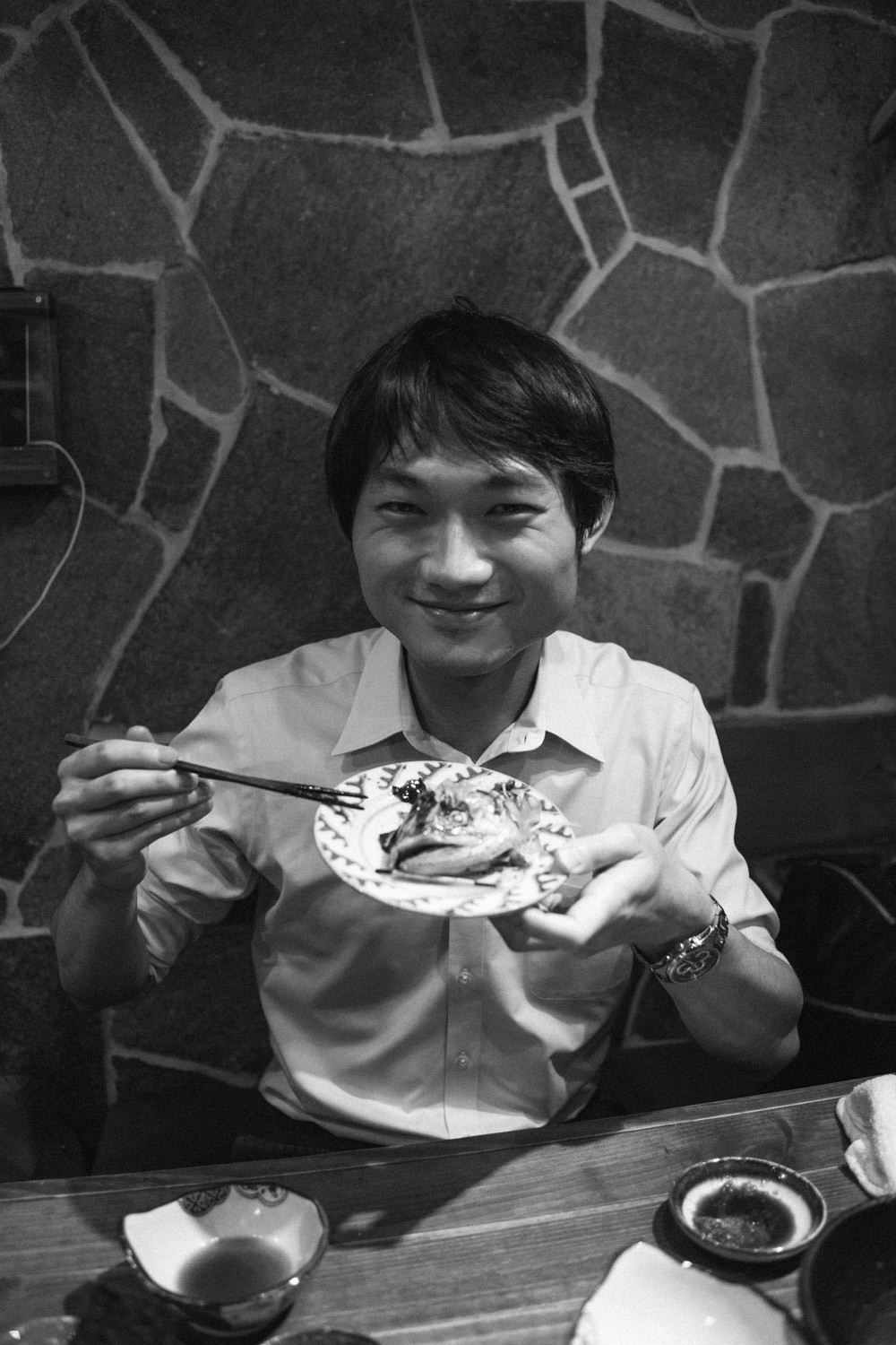 Satoshi  Holding the head of a fish