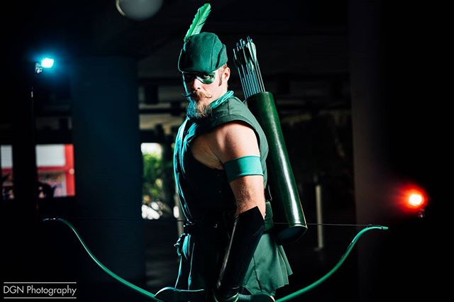 | Green Arrow | Man, my lighting sure has improved in the months since I first got my speed lights. Goes to show that you don't always need $3,000 lights... But I still want $3,000 lights 😭😭@longbeach_cc was seriously a blast despite the heat.  ___ Cosplayer | @slcgreenarrow  Camera | Sony A7RII Lens | Sony 85mm f/1.8 Lights | 3 Yongnuo 560 MK IV's  Software | Adobe Lightroom ____ Green Arrow and Speedy first appeared in More Fun Comics 73 (cover-dated November 1941), which was illustrated by artist George Papp. When Mort Weisinger was creating the character, aside from the obvious allusions to Robin Hood, took inspiration from a movie serial, The Green Archer, based on the novel by Edgar Wallace. He retooled the concept into a superhero archer with obvious Batman influences. These include Green Arrow's sidekick Speedy, his use of an Arrowcar and Arrow-Plane for transportation, his use of an Arrow-Cave as his headquarters, his alter ego as a billionaire playboy, the use of an Arrow-Signal to summon him, as well as a clown-like arch foe named Bull's Eye, similar to Batman's arch-foe, the Joker. His and Speedy's first origin stories were told in More Fun Comics 89. ___ #longbeachcomiccon #lbcc #lbcc2017 #dragoncon #dragoncon2017 #pax #pax2017 #dccomics #greenarrow #greenarrowcosplay #oliverqueen #guyswhocosplay #superhero #justiceleague #batman #wonderwoman #greenlantern #sdcc