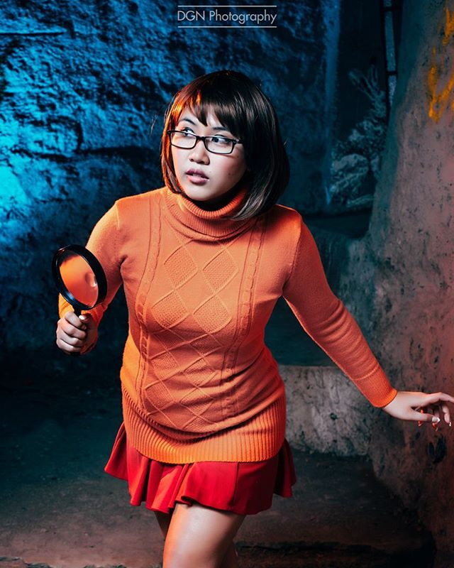 "| Velma Dinkley| Yeah, expect more Velma shoots lol.  ____  Cosplayer | @redrabbu Character | Velma Dinkley Camera | Sony A7RII @sonyalpha Lens | Sony 85mm f/1.8  Software | Adobe Lightroom ____ Scooby-Doo is an American animated cartoon franchise, comprising several animated television series produced from 1969 to the present day. The original series, Scooby-Doo, Where Are You!, was created for Hanna-Barbera Productions by writers Joe Ruby and Ken Spears in 1969. This Saturday-morning cartoon series featured four teenagers—Fred Jones, Daphne Blake, Velma Dinkley, and Norville ""Shaggy"" Rogers—and their talking brown Great Dane named Scooby-Doo, who solve mysteries involving supposedly supernatural creatures through a series of antics and missteps ____ #dappergeeknews #cosplaygirl #cosplay #cosplayer #cosplaying #girlswhocosplay #girlsofcosplay #velma #velmacosplay #scoobydoo #jinkies#lamolecomiccon #ax2017 #animeexpo2017 #colossalcon #ccxp #animeexpo #supanova #mcmlondoncomiccon #scoobysnack #animelosangeles #sonyalpha #zeiss"