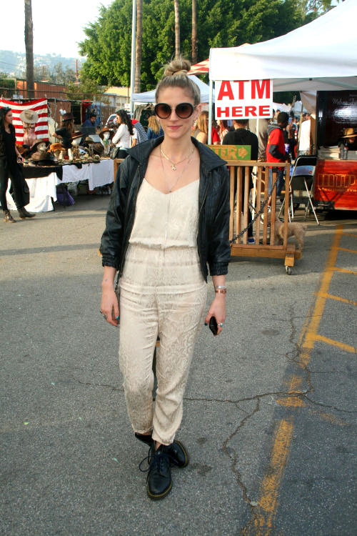 Pairing a cream silk jumper and layered necklaces with Dr. Martens boots and a leather bomber jacket - this fashion influencer rocked a perfect combination of delicate garments with bold and edgy statement pieces.   –  Melrose Trading Post  Los Angeles, Ca  Neighborhood:  Melrose