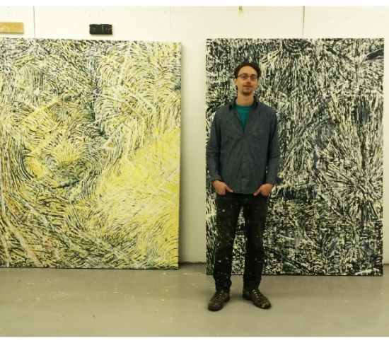 Keenan Derby photographed with his work.