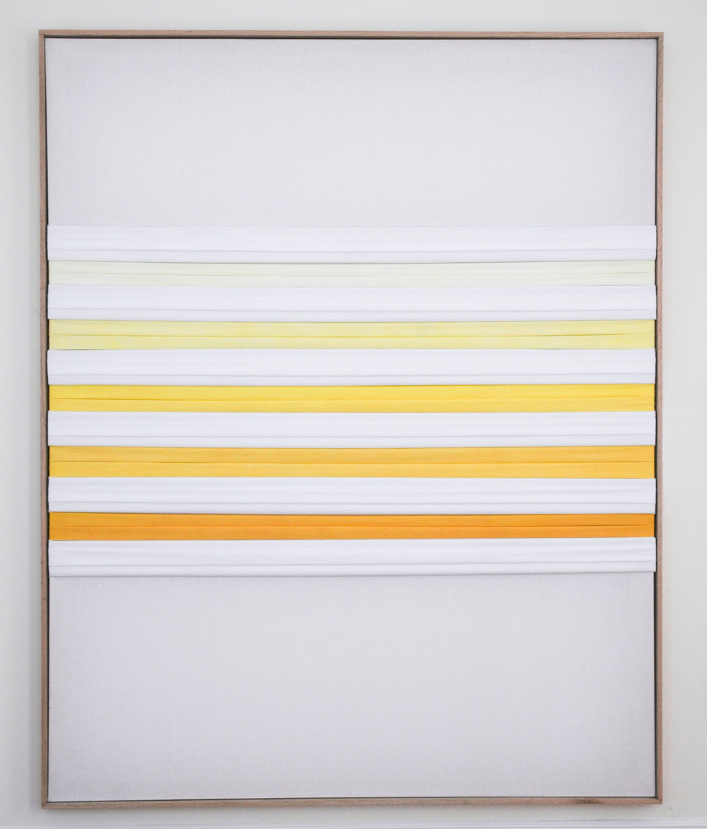 <b>Flag Turmeric</b><br>White cotton and turmeric with red oak frame<br>80 x 64 in.