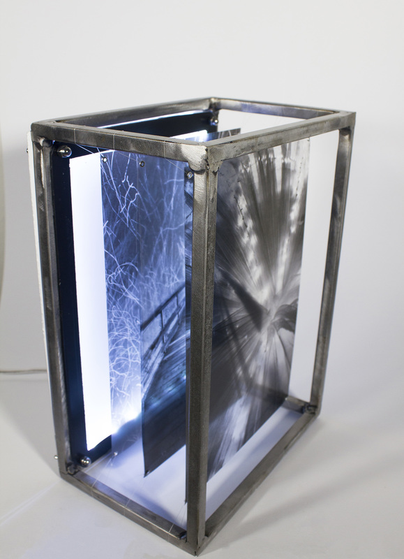 Kristina McComb,  Lacy Pathways  (2015). steel, plexiglass, and transparent film. 14 x 10 x 7 in.