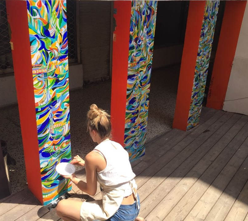 Wróbel working on her public art project at the Rena House, in Tel Aviv, Israel, image courtesy of the artist.