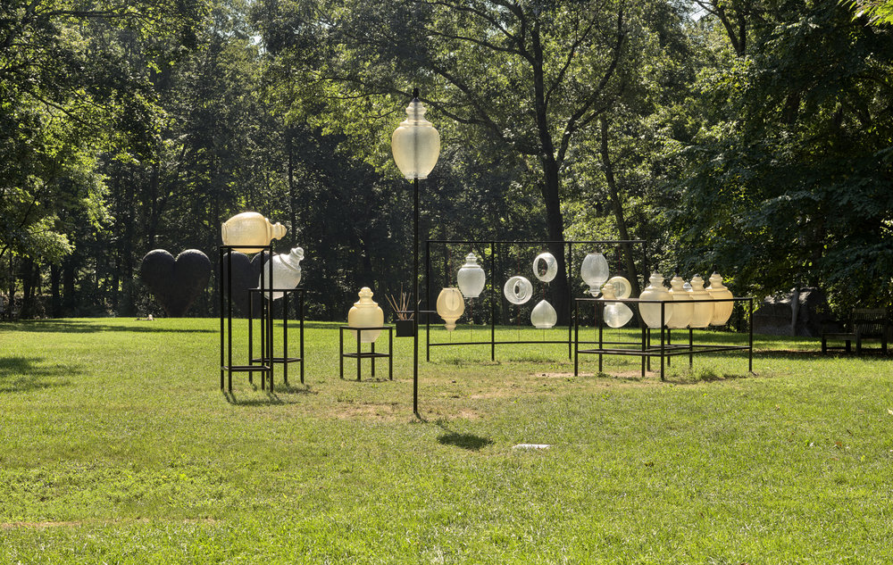 Andy Graydon,  City Lights Orchestra , 2018, used street lamps, steel, airline cable, Courtesy of the artist, Photograph by Clements Photography and Design, Boston. Source: deCordova website.