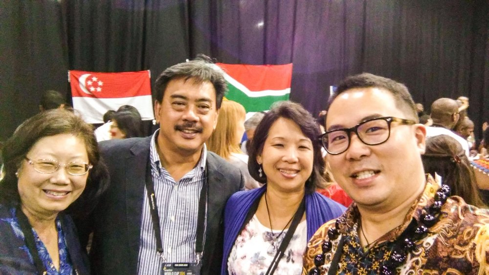 Mr Gerard Chai (second from left) with his wife and staff from Enactus Singapore