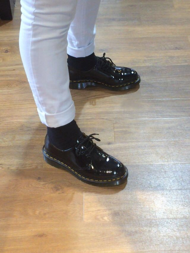 Trying on my new shoes in the Dr. Marten shop in Belfast
