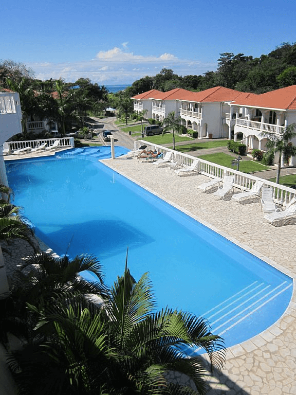 Sunset Villas pool Caribbean Colors Rentals.png