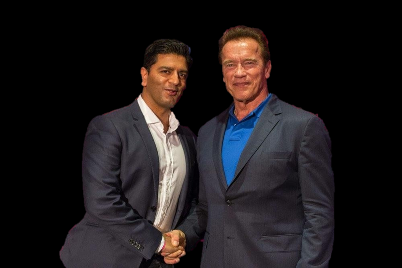 Ron with Arnold Schwarzenegger