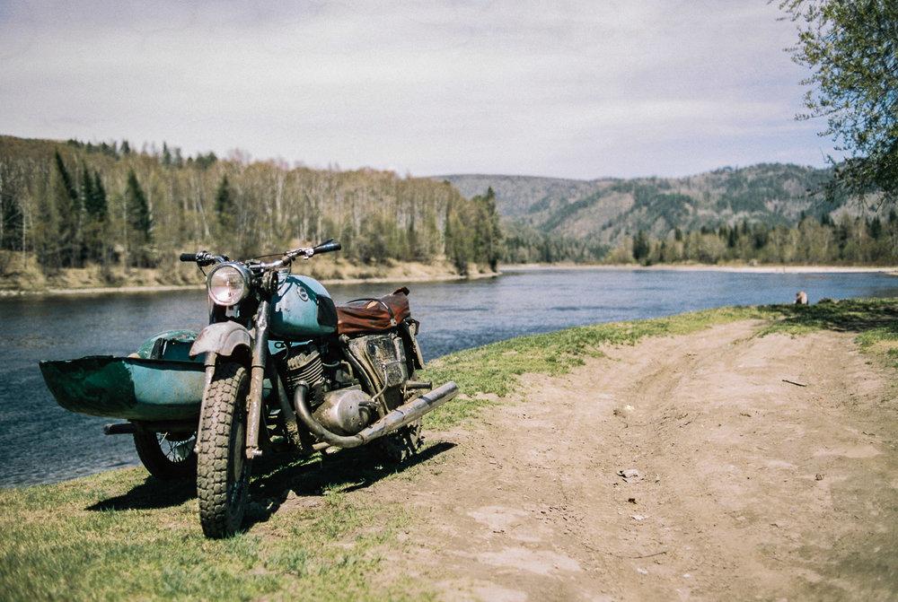 The river which runs behind Nikolay's house. Nikon FM3a and Cinestill 50D