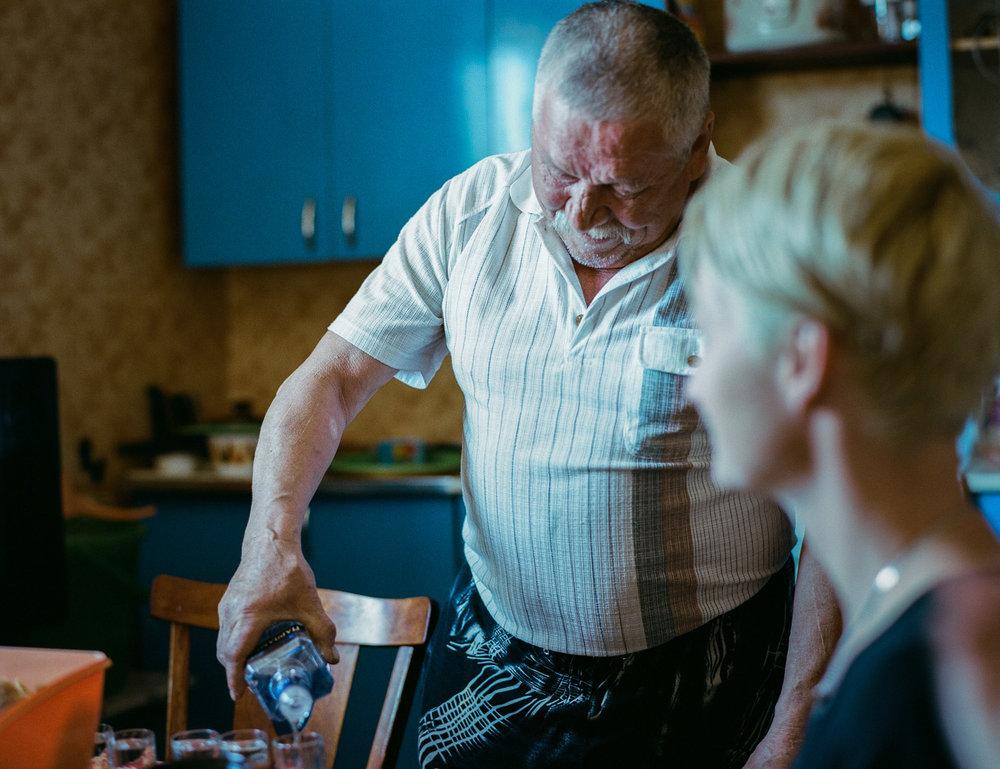 Nikolay's father is pouring a refreshment. Photo: Contax 645 + kodak