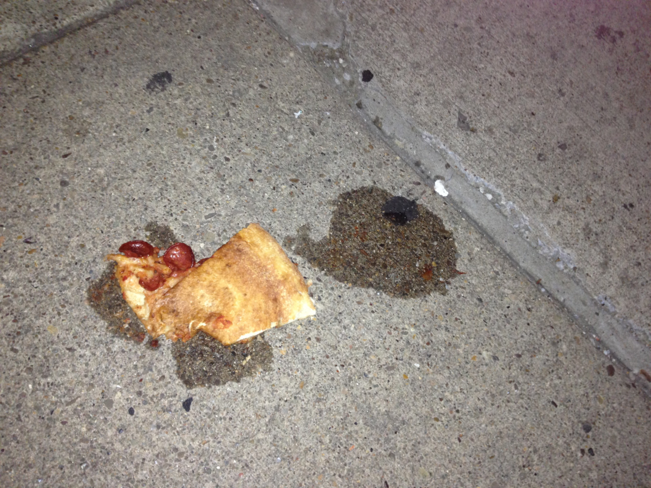 Law & Order: Pizza Victims Unit. Along a dismal sidewalk that can't make up its mind between being dark grey or slate grey, lies this poor pizza. This sidewalk, much like the neighbors, is indifferent to the corpse of a pizza. Just a standard note in the harmony of life. The pizza, young and full of pepperoni, was mangled and sliced in half. The grease marks left behind are plentiful and denote a playful death. This pizza did not go quiet into the good oven.