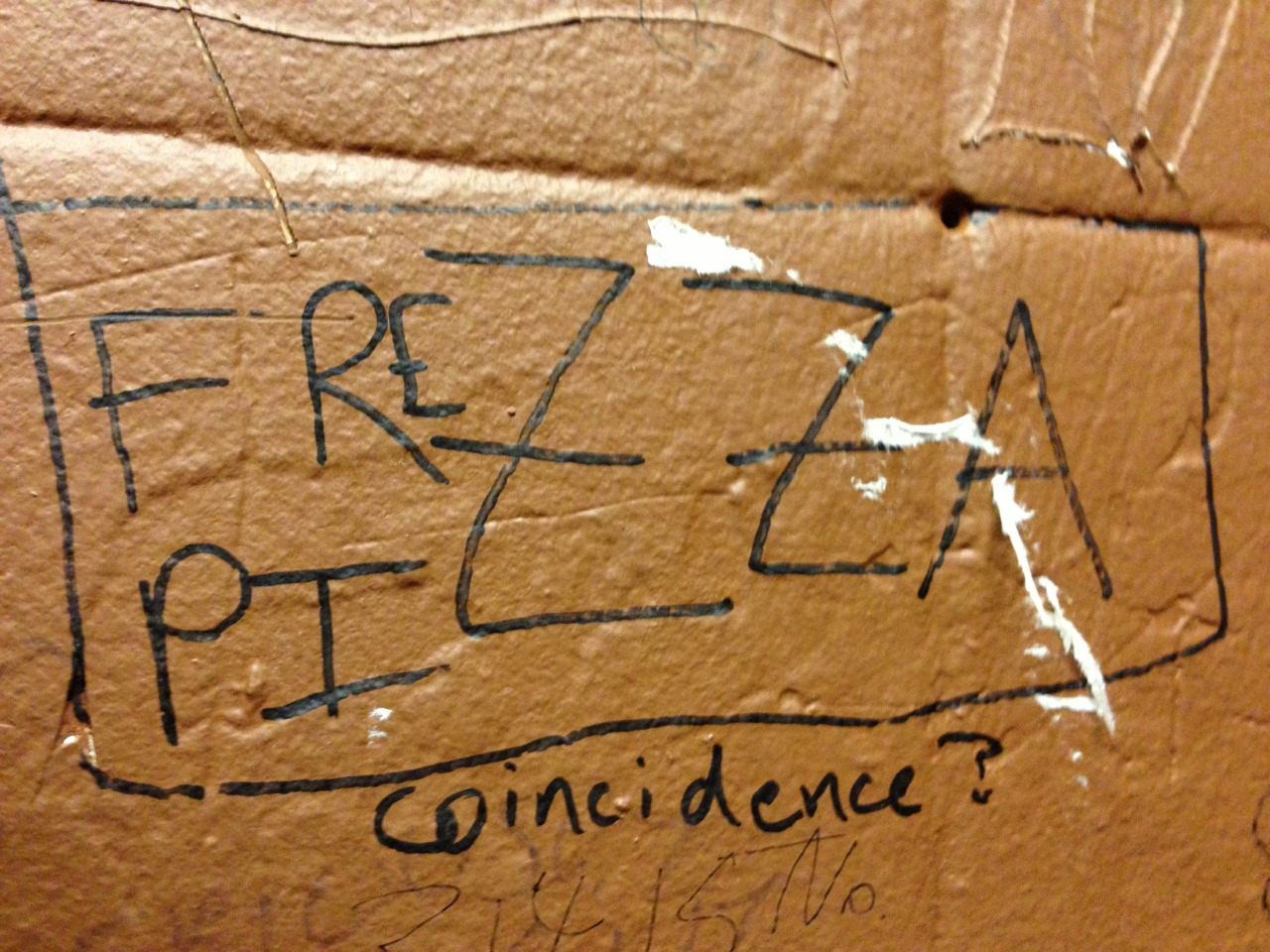 "Some graffiti I found in a bar. Most of the drawings on the wall were in reference to ""Frezza."" I can only assume that Frezza is some sort of pizza god."