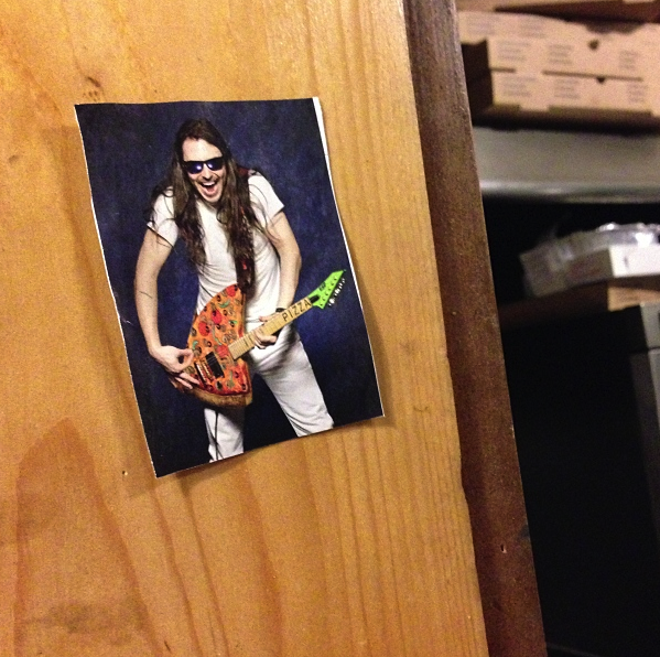 Last July  this photo of Andrew W.K.  shredded across the Internet. Who knew such a party-freak would create this delicious hybrid? A harmony of cheeses, sauces, and music.   Nearly a year later, Andrew W.K. is on tour across America ( he'll be in Pittsburgh on May 19 ) and this photo is proudly hung in S pak Brother's pizza . I went to take a photo of this photo and the guy behind the register told me that Andre W.K. knew that this photo was taped to that wall.   Yes, word got back to Andrew W.K. that his pizza guitar was hanging inside a pizzeria. So, of course Andrew W.K. does what any other party expert would do. He sent them a package of autographed photos. I assume it was to reward Spak for supplying so many pizza parties.   So there you have it - Andrew W.K. is a standup guy who can appreciate pizza through and through. Perhaps when he's in Pittsburgh this May I can interview him about his pizza experience.
