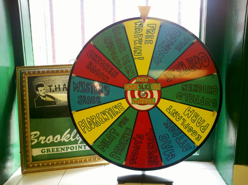This makes me want to open up a pizza shop so hard. specialbored: Vinnie's Pizzeria presents The IndeSLICEive Wheel. For all our lovely customers who just can't decide what to get, we say leave it to chance.