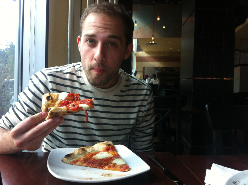 "Here's me eating some Varasano's pizza. The face I'm making in this photo is called ""legit."" I'll post more photos, tips and tricks from the owner, a review, and probably an interview with someone later. Get hyped! Pizza hyped!"