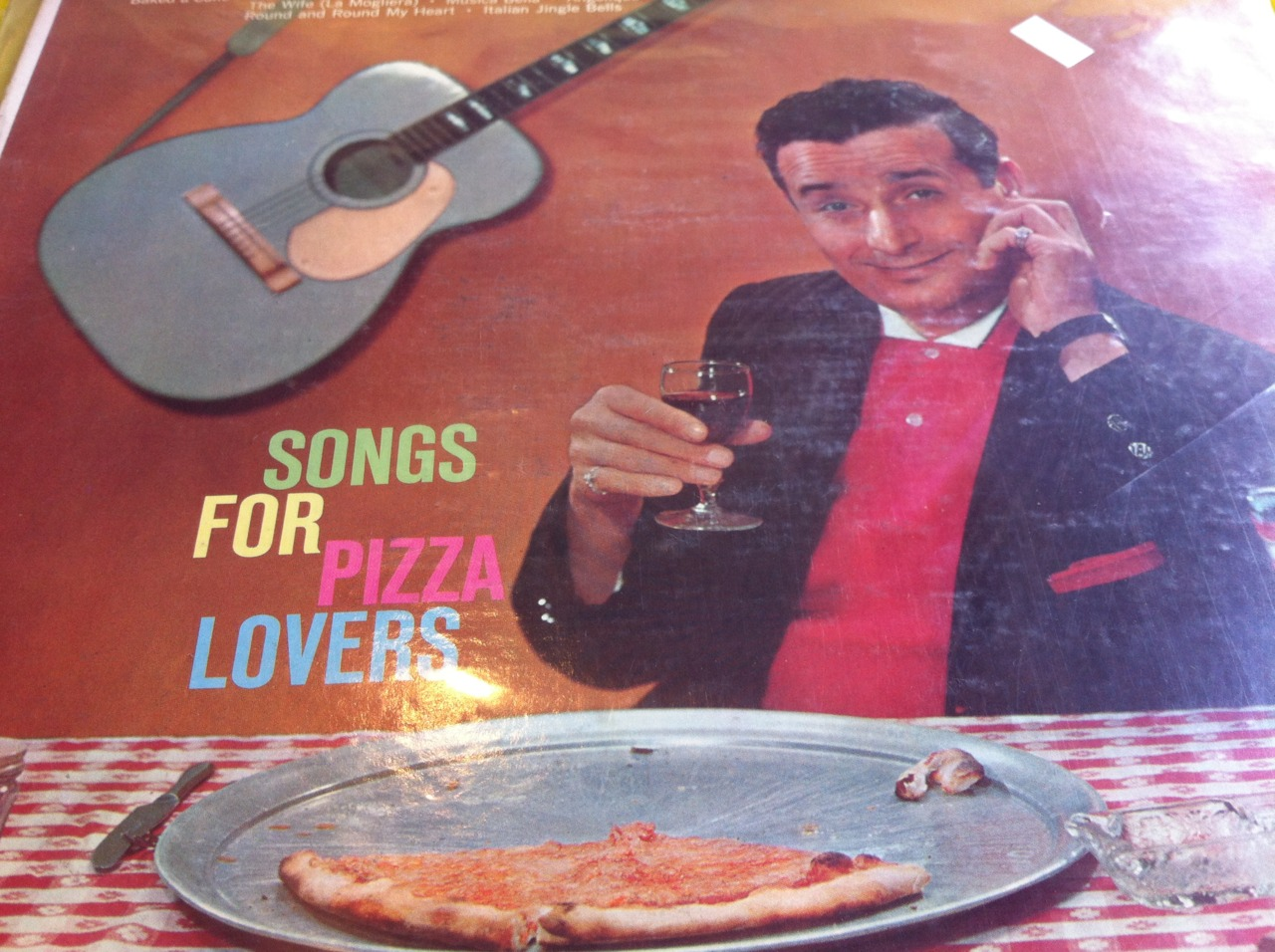 "I haven't listened to much of this record yet, but it has such classics as ""If I knew You Were Coming I'd Have Baked You a Cake."" In this instance, ""cake"" must mean pizza. A pizza cake. Exactly the type of thing I want served at my funeral. This guy on the front seems to enjoy pizza so much that he's eaten most of it before the camera crew could get a slice. This is before unions so no one was allowed to intervene on the pizza slaughter. It's a shame that there's a piece of crust left behind. A pizza lover would eat the entire pizza, crust and all. Kind of makes me think this might just be a marketing ploy to sucker in pizza enthusiast.  I'll make some pizza and listen to the record and write a review of the songs. Who knows, maybe it'll inspire me to write my own pizza lyrics. Lyrics that, if listened to in reverse, reveal my deepest pizza secrets."