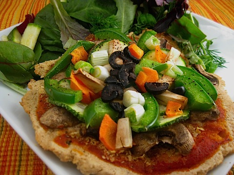 "It was yesterday when I asked a friend of mine, who is basically a wizard of health and fitness, about healthy pizza. I expected her to say, ""Oh, just cut down on some cheese,"" or, ""Use so many veggies that a rabbit would get queasy eating the pie."" Unfortunately, she sent me recipe involving a tortilla as a crust and when I read that my eyes shriveled up and my stomach came to a halt. I like to take risks, but the idea of substituting a tortilla in for a flour-based crust. What purpose does flour, yeast, and water have if it's not for a pizza? We can't have tortillas coming in here stealing all the pizza jobs. Tortillas already have a place in this world! This morning I stumbled upon this recipe for a healthy pizza. It involves oats, so you know it's bonafide. This pizza looks like pizza and it's something that's not going to cause your body to shutdown the rest of its functions as it tries to digest the disc.  Maybe I'll make some this weekend for a pizza review? Who knows! Read on for the recipe. gourmetgrub: Oatmeal Crust Veggie Pizza Prep Time: 15 minutes Assembly/ Cook Time: 40-50 minutes Serving Size: 3 palm sized crusts Ingredients: For crust: 1 package active dry yeast ¾ cup warm water (separated into ¼ cup for proofing and ½ cup for mixing the dough) ¼ teaspoon sugar 1 1/2 cups oat flour ½ teaspoon salt For pizza (individual serving): ¼- 1/3 cup of your favorite tomato sauce ¼ cup mozzarella cheese (I substituted nutritional yeast- not the same, but works in a pinch) 1/8 cup mushrooms, sliced 1/8 cup green pepper, diced 1/8 cup carrots, thinly sliced 1/8 cup zucchini, thinly sliced 1/8 cup green onion, sliced Black olives Salt and pepper to taste Instructions: Preheat oven to 500 degrees. Proof your yeast by combining ¼ cup warm (but not hot) water, ¼ tsp sugar, and package of yeast in a small bowl. Let sit for about 8 minutes. While the yeast is proofing, process oats until they become a fine flour. In a large bowl, combine oat flour and salt. Then add yeast mixture and additional ½ cup water. Mix until well combined. Spread out dough on a pan. You can make one large crust (cooking time may vary) or three palm-sized individual crusts. Bake in the oven for 10-15 minutes, or until golden brown. While the crust is baking, prep your sauce and vegetables for the crust. Remove crust from oven and reduce temperature to 350. Put sauce and toppings onto crust to your desired liking. Return the pizza to the oven and bake for 15-20 minutes, or until vegetables are cooked and cheese is melted."