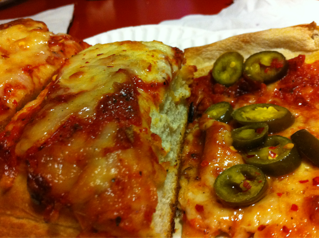 "The ""Dangerous Duo"" from Mineo's. If you ask for that at the counter they won't give you this, but you'll probably be escorted to the back to look at a mop and bucket I don't know why I decided to get jalapeños on that slice. It seemed like a good idea at the time, but they ultimately didn't offer interesting to the experience. It was just more shrapnel I had to deal with. Has anyone ever had a good topping experience at Mineo's?"