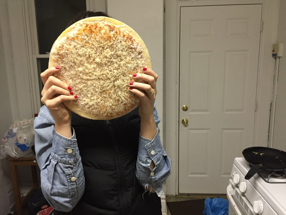 Christa poses with the Cappello's frozen pizza.  As you can see, it's a nice size for two people to snack on.