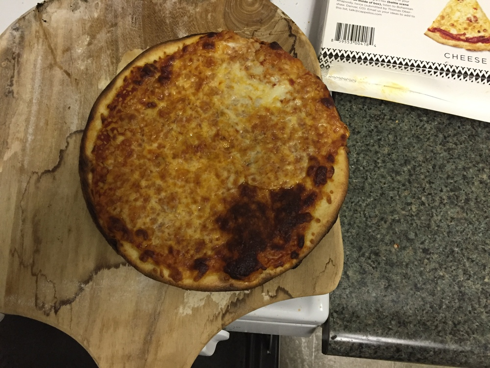 Here's the Cappello's pizza fresh from the oven. It's charred in some places and tan in others.