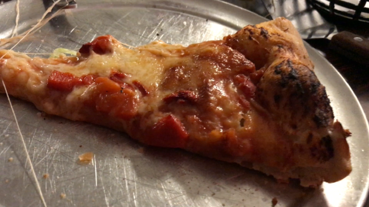 A bare, innocent slice of Fiori's pizza.