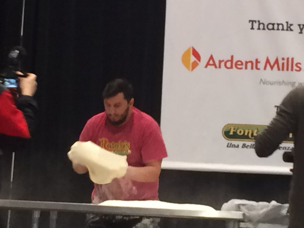An action shot of the dough stretching competition in the 2017 World Pizza Games