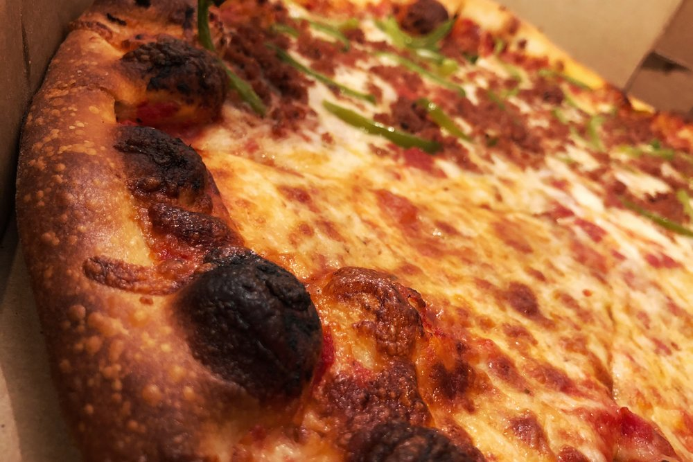 Above you can see a practically perfect in every way pizza. The crust is the right kind of brown, charred in the right spots, and you have an even layer of cheese that covers the sauce just so.