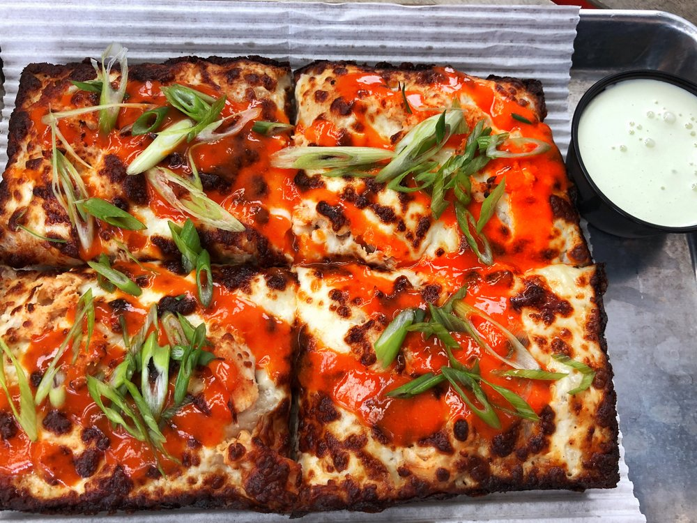 An aerial view of Michigan & Trumbull's Buffalo Chicken Pizza