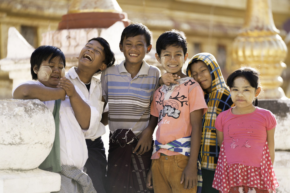 Faces of Bagan.  Kids at Shwe Zi Gong pagoda that can recite the history of the pagoda in 5 different languages.