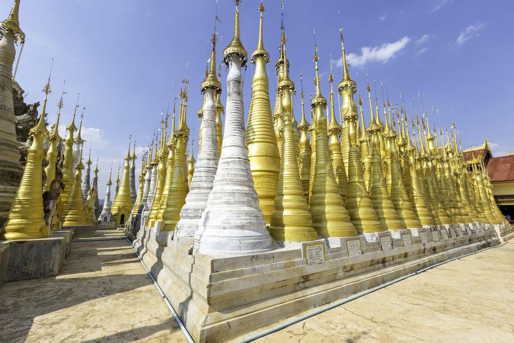 Shwe Inn Thein Pagoda   Hundreds of pagoda near Inle Lake.