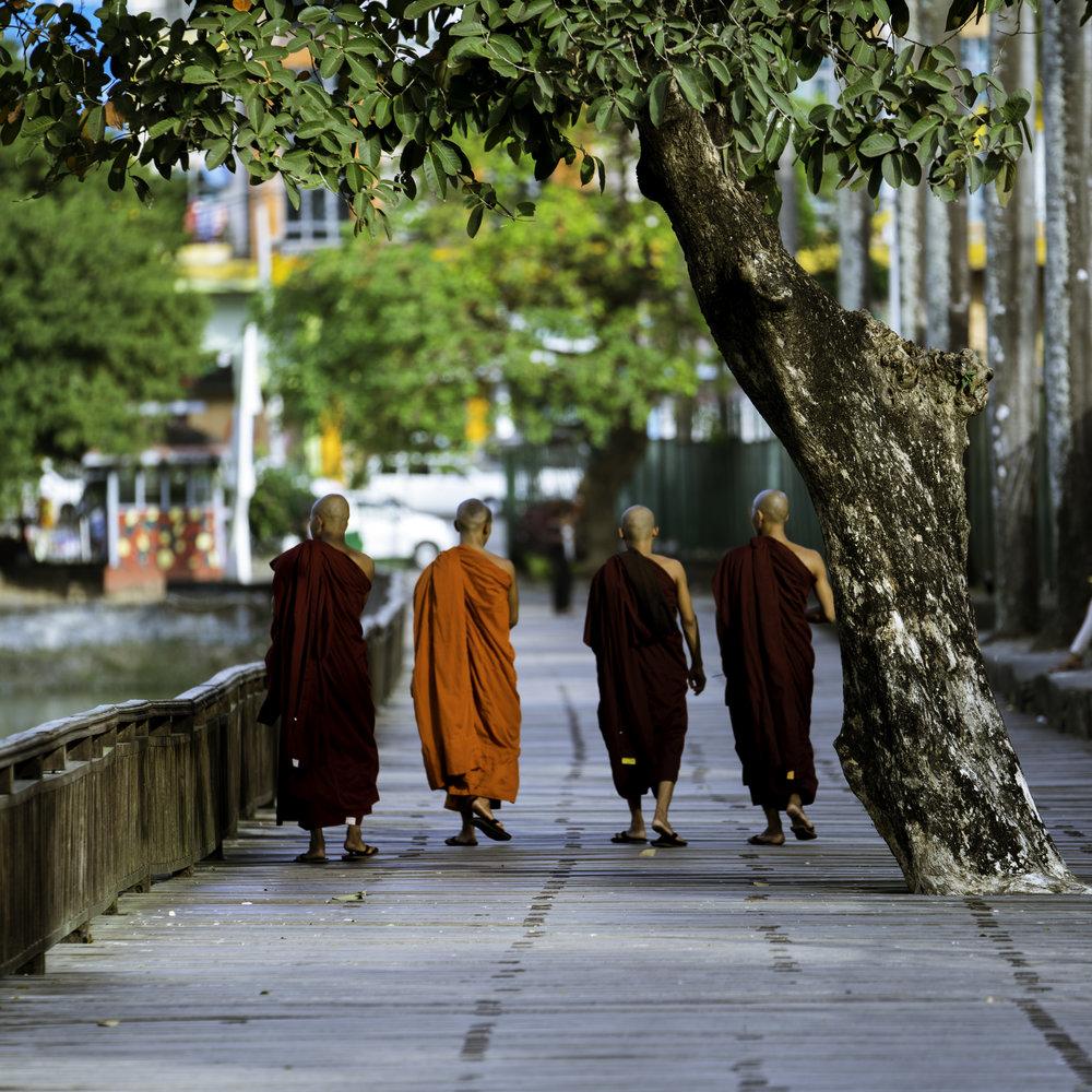 Monks at Kandawgyi.  Local monks touring the Kandawgyi lake.