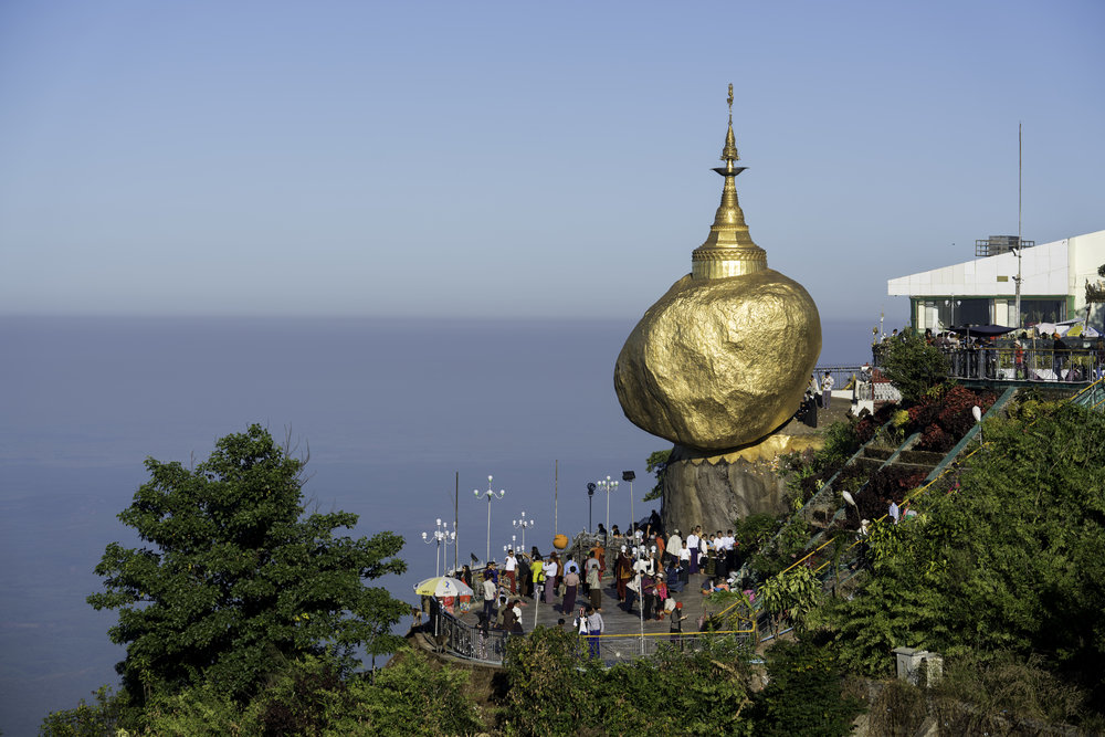 Kyaik Htee Yoe Pagoda overlooking a cliff.  The fame of this golden rock comes from it's seemingly magical ability to balance itself over a cliff.