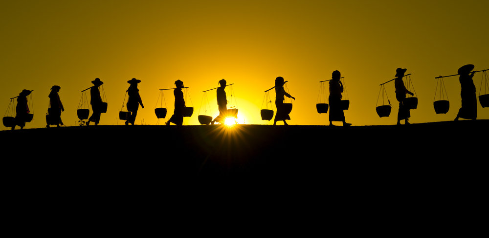 People of Bagan.  Villagers on the way home from a harvest.