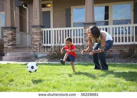 stock-photo-mother-and-son-in-front-yard-playing-with-soccer-ball-36228661.jpg