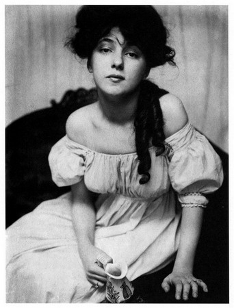 Miss N (Evelyn Nesbit) - by Gertrude Kasebier  Pictorialist portrait photographer Kasebier was one of the most celebrated and well paid artists of her time. Note the allegorical grasp of the pitcher and forward leaning voluptuous pose, typical to pictorialist style.  Image created in 1898 and published within  Camera Work 1  in 1903.