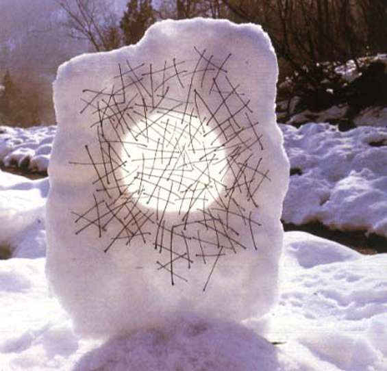 Image Description: An Andy Goldsworthy sculpture of translucent snow with a matrix of sticks.